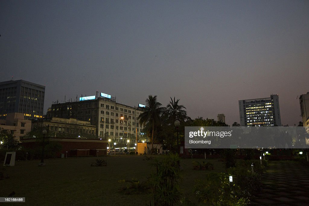 Buildings stand in the evening in Kolkata, India, on Tuesday, Feb. 19, 2013. India's slowest economic expansion in a decade is limiting profit growth at the biggest companies even as foreigners remain net buyers of the nation's stocks, according to Kotak Institutional Equities. Photographer: Brent Lewin/Bloomberg via Getty Images