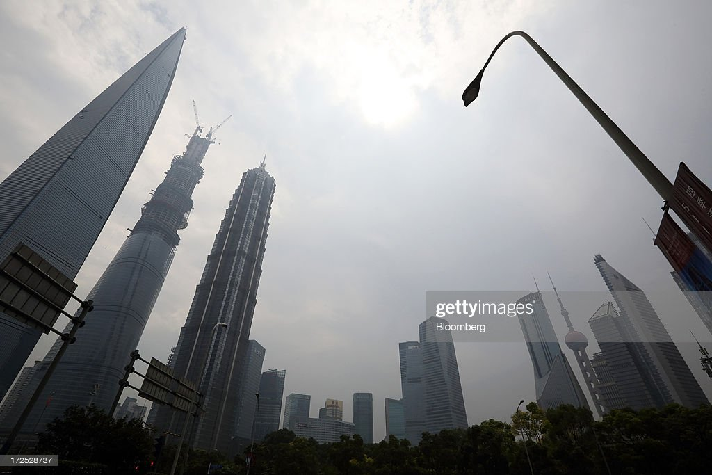 Buildings stand in the Lujiazui financial district in Shanghai, China, on Monday, July 1, 2013. Chinese banks' valuations are close to their lowest on record as the nation's interbank funding crisis exacerbated investors' concern that earnings growth will stall and defaults may surge as the economy slows. Photographer: Tomohiro Ohsumi/Bloomberg via Getty Images