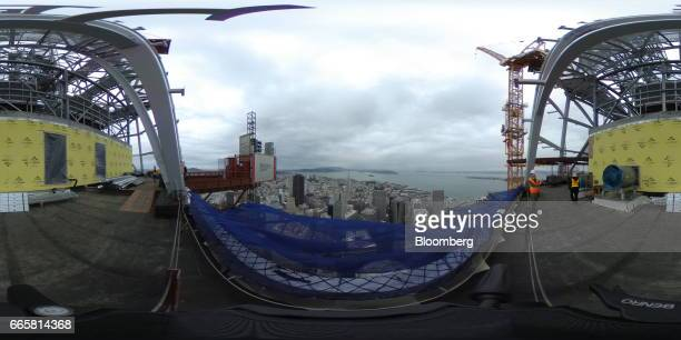 Buildings stand in the skyline during a topping off ceremony for the Salesforce Tower in San Francisco California US on Thursday April 6 2017 The...