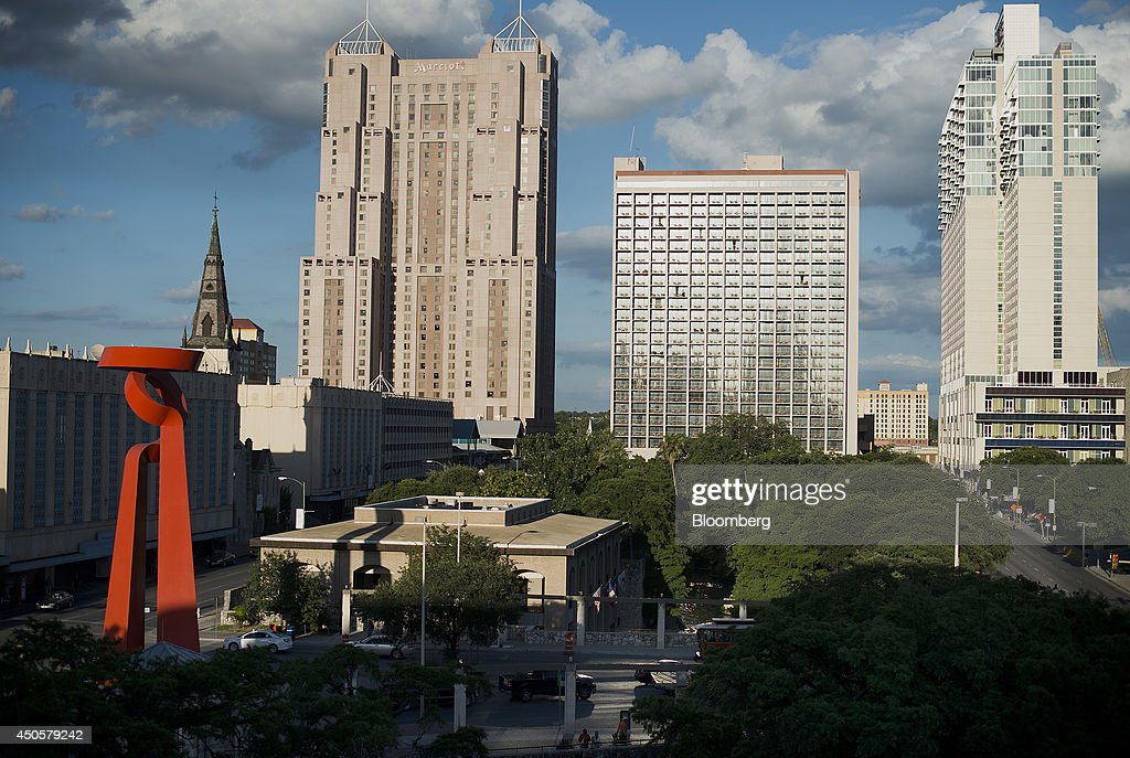 Buildings stand in the skyline of downtown San Antonio Texas US on Wednesday June 4 2014 Localities in Texas home to seven of the nation's 15...