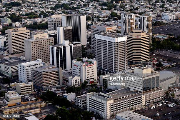Buildings stand in this aerial photograph taken above San Juan Puerto Rico on Thursday Aug 13 2015 Puerto Rico bonds may become attractive after the...