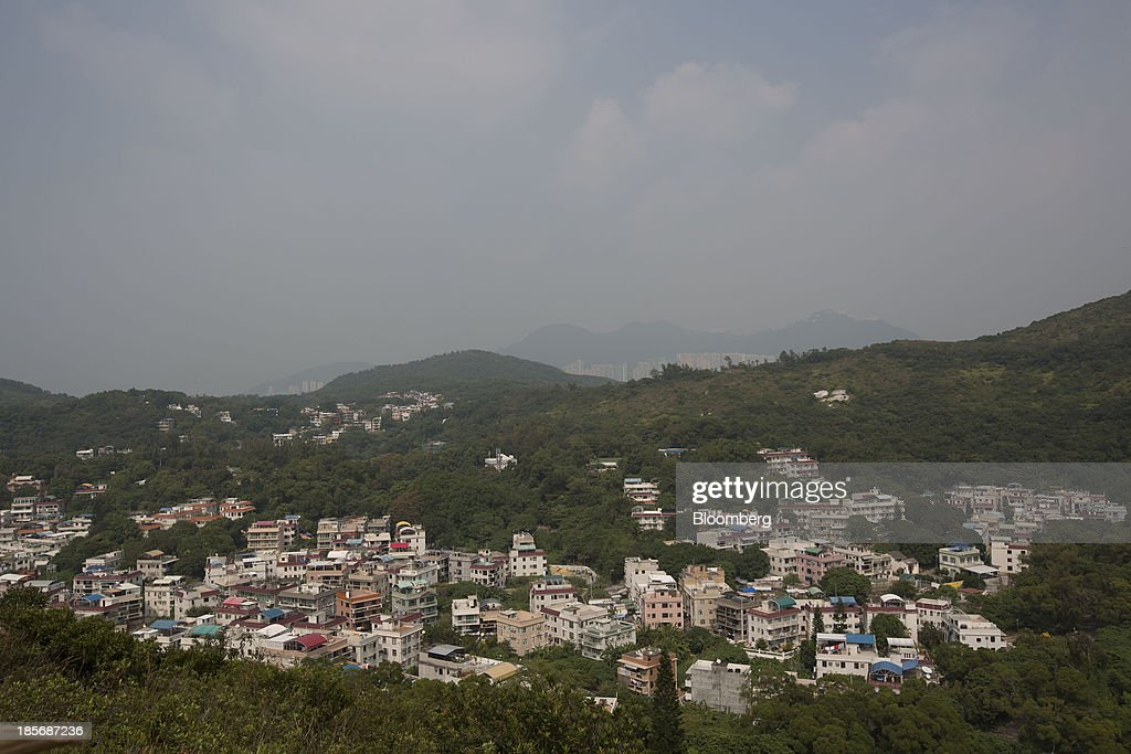 Buildings stand on Lamma Island in Hong Kong China on Tuesday Oct 22 2013 Hong Kong has the world's highest home prices most expensive retail rents...