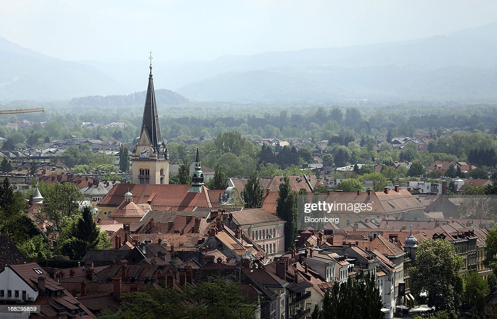 Buildings stand on the city skyline in the old town of Ljubljana, Slovenia, on Tuesday, May 7, 2013. Slovenia plans to increase taxes to make up for the swelling budget shortfall as the country works to recapitalize its banks. Photographer: Chris Ratcliffe/Bloomberg via Getty Images