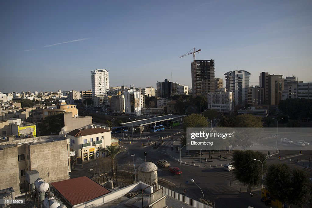 Buildings stand on the city skyline on the Greek side of Nicosia, Cyprus, on Wednesday, March 20, 2013. European policy makers weighed how far to push Cyprus after lawmakers in the Mediterranean nation rejected an unprecedented levy on bank deposits, throwing into limbo a rescue package designed to keep it in the euro. Photographer: Simon Dawson/Bloomberg via Getty Images