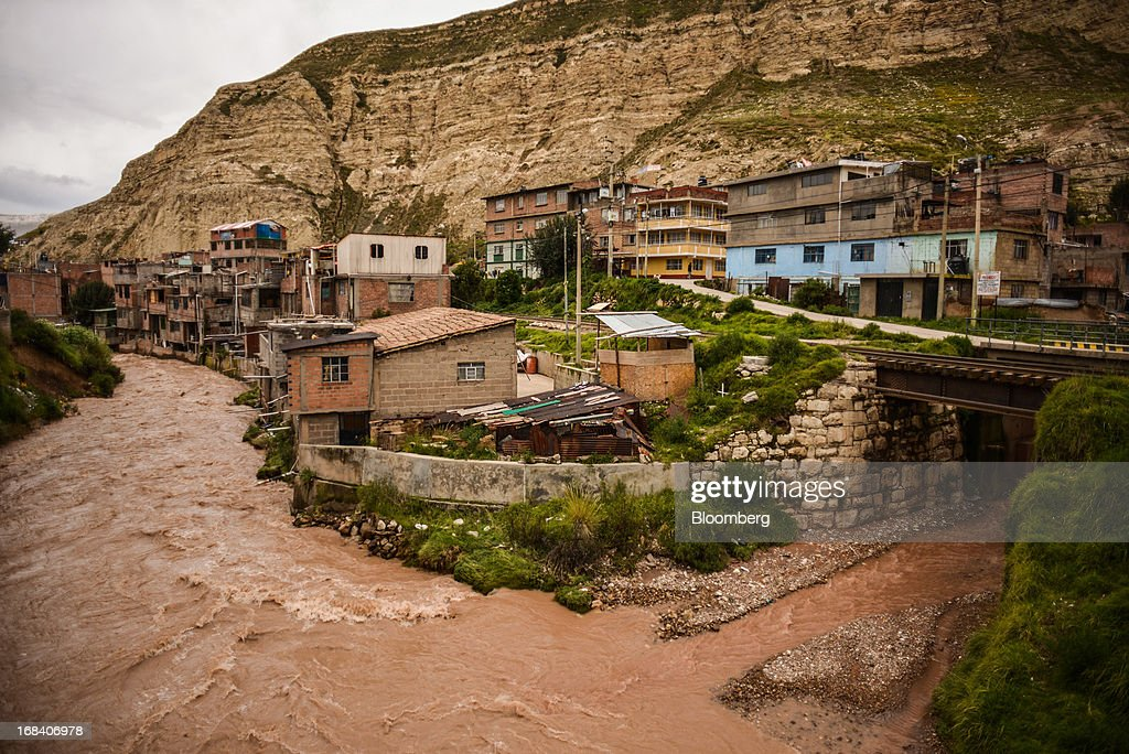 Buildings stand on the Mantaro River in the town of La Oroya, Peru, on Tuesday, March 19, 2013. Most of La Oroyaís children suffer elevated lead levels, according to the Peruvian government. The question of responsibility for lead pollution in La Oroya is at the center of high-stakes clash between Peru and U.S. billionaire Ira Rennert, who owned Doe Run Peru for more than a decade through Renco Group Inc., a metals, mining and industrial conglomerate based in New York that has said it is not responsible for the childrenís ills. Photographer: Meridith Kohut/Bloomberg via Getty Images