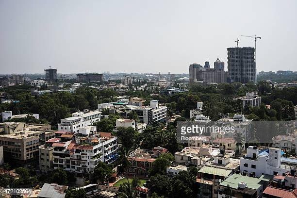 Buildings stand under construction among other commercial and residential property in Bangalore India on Sunday May 3 2015 India's Finance Minister...