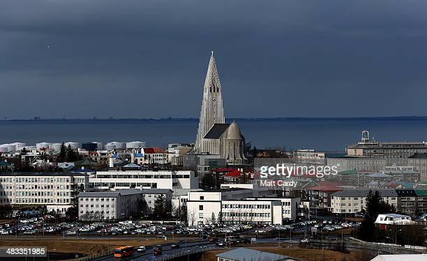 Buildings surround the Hallgrimskirkja tower in the Icelandic capital on April 7 2014 in Reykjavik Iceland Since the financial meltdown of 2008 which...