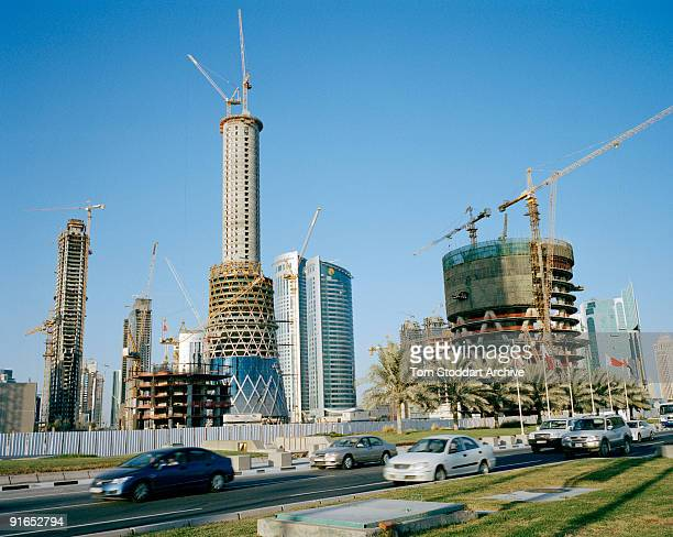 Buildings under construction along the corniche in Doha Qatar May 2008