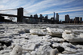 A buildup of ice is viewed in the East River near the Brooklyn Bridge on February 23 2015 in New York City New York City and much of the East Coast...