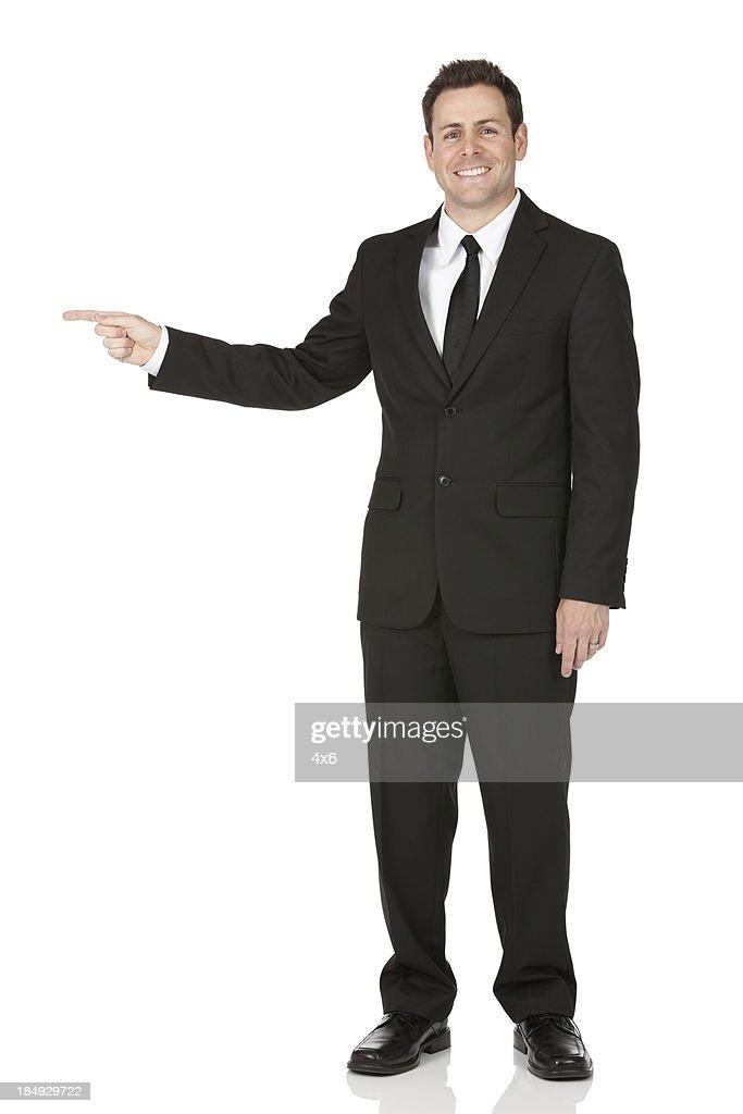 Buinessman pointing sideways