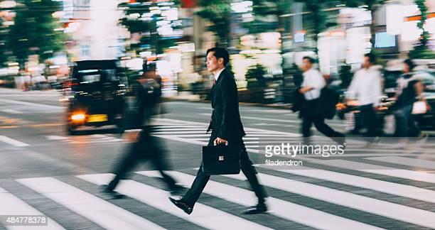 Buisnessman crossing the street