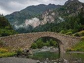Bujaruelo ancient bridge in Pyrinees range, spain