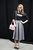 Buket Guler poses waring a Karl Lagerfeld top Asos skirt Zanotti shoes and Miu Miu bag on February 28 2015 in Milan Italy