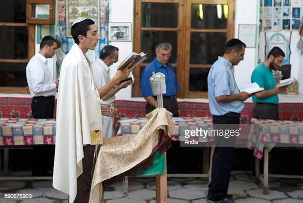 Bukhara Synagogue beginning of Sabbath jewish people reading the Torah Jewish religion prayer