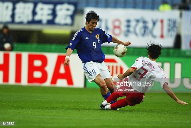 Bulent Korkmaz of Turkey wins the tackle against Akinori Nishizawa of Japan during the FIFA World Cup Finals 2002 Second Round match played at the...