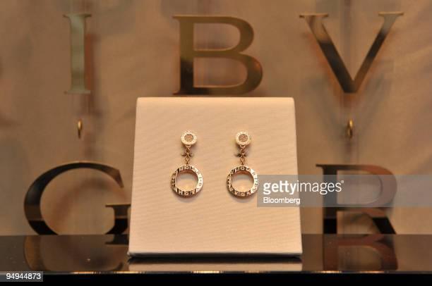 Bulgari earrings sit on display in the window of the Bulgari shop situated on the Via Condotti in Rome Italy on Monday March 9 2009 Bulgari SpA the...