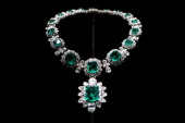 Bulgari necklace of Colombian emeralds surrounded by diamonds supporting a large pendent emerald of 2344 carats owned by actor Elizabeth Taylor on...