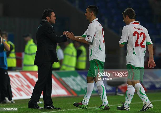 Bulgaria coach Lothar Matthaus congratulates scorer Ivelin Popov after the EURO 2012 Group G Qualifier between Wales and Bulgaria at Cardiff City...