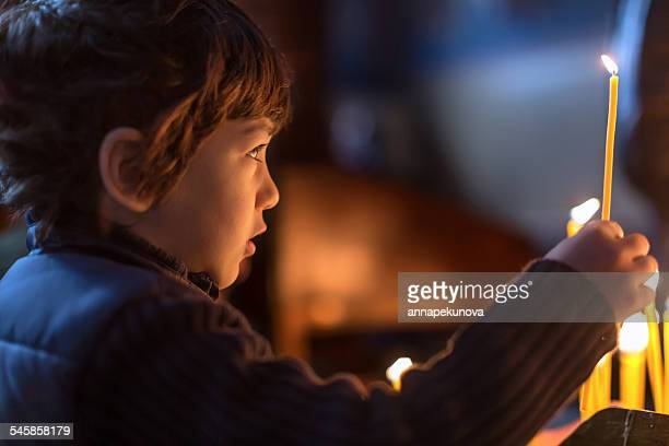 Bulgaria, Sofia, Young boy (4-5) holding candle