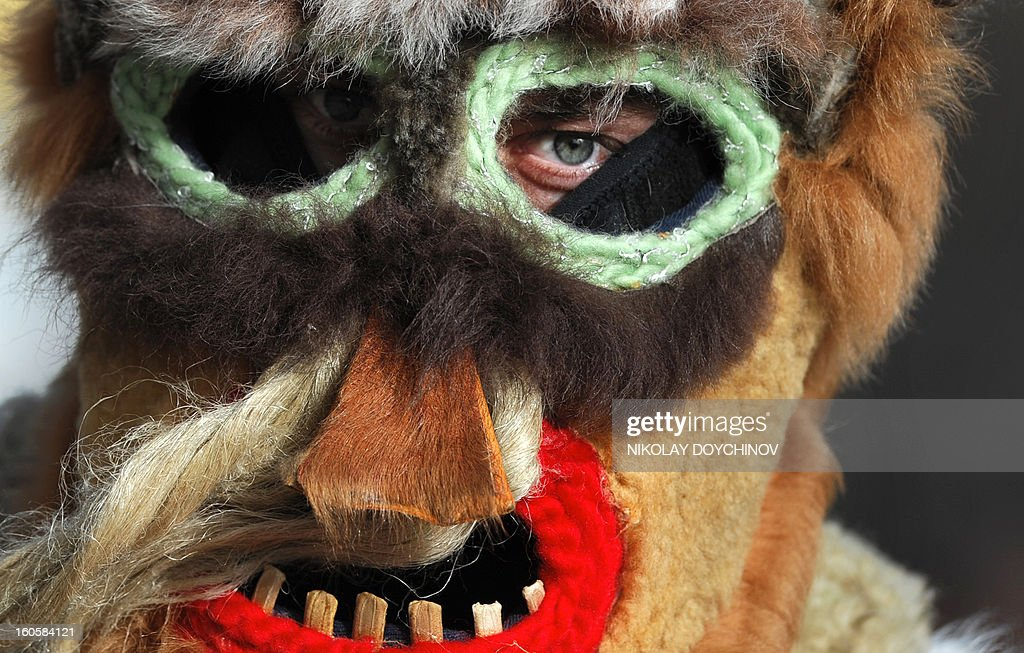 Bulgarian dancer dressed as 'Kukeri' performs a ritual dance during the International Festival of the Masquerade Games in Pernik near the capital Sofia, on February 3, 2013. The three-day festival, which started on February 1, has participants sporting multi-colored masks, covered with beads, ribbons and woolen tassels while the main dancer, ladened with bells to drive away sickness and evil spirits, sways like a wheat spikelet heavy with grain.