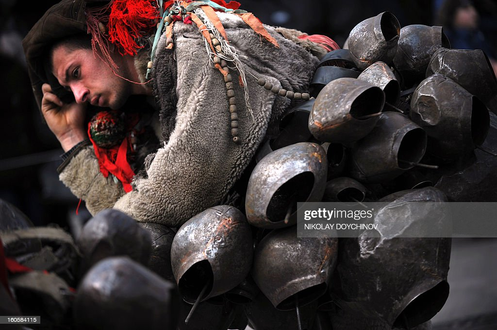Bulgarian dancer dressed as 'Kukeri' waits for his performans during the International Festival of the Masquerade Games in Pernik near the capital Sofia, on February 3, 2013. The three-day festival, which started on February 1, has participants sporting multi-colored masks, covered with beads, ribbons and woolen tassels while the main dancer, ladened with bells to drive away sickness and evil spirits, sways like a wheat spikelet heavy with grain.