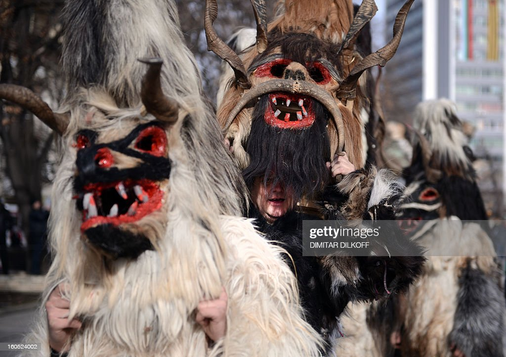 Bulgarian dancers known as 'kukeri' attend a ritual dance during the International Festival of the Masquerade Games in Pernik near the capital Sofia, on February 2, 2013. The three-day festival, which started on January 28, has participants sporting multi-colored masks, covered with beads, ribbons and woolen tassels whlie the main dancer, ladened with bells to drive away sickness and evil spirits, sways like a wheat spikelet heavy with grain.