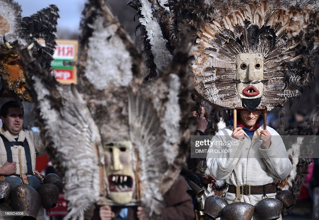 Bulgarian dancers known as 'kukeri' perform a ritual dance during the International Festival of the Masquerade Games in Pernik near the capital Sofia, on February 2, 2013. The three-day festival, which started on January 28, has participants sporting multi-colored masks, covered with beads, ribbons and woolen tassels whlie the main dancer, ladened with bells to drive away sickness and evil spirits, sways like a wheat spikelet heavy with grain.