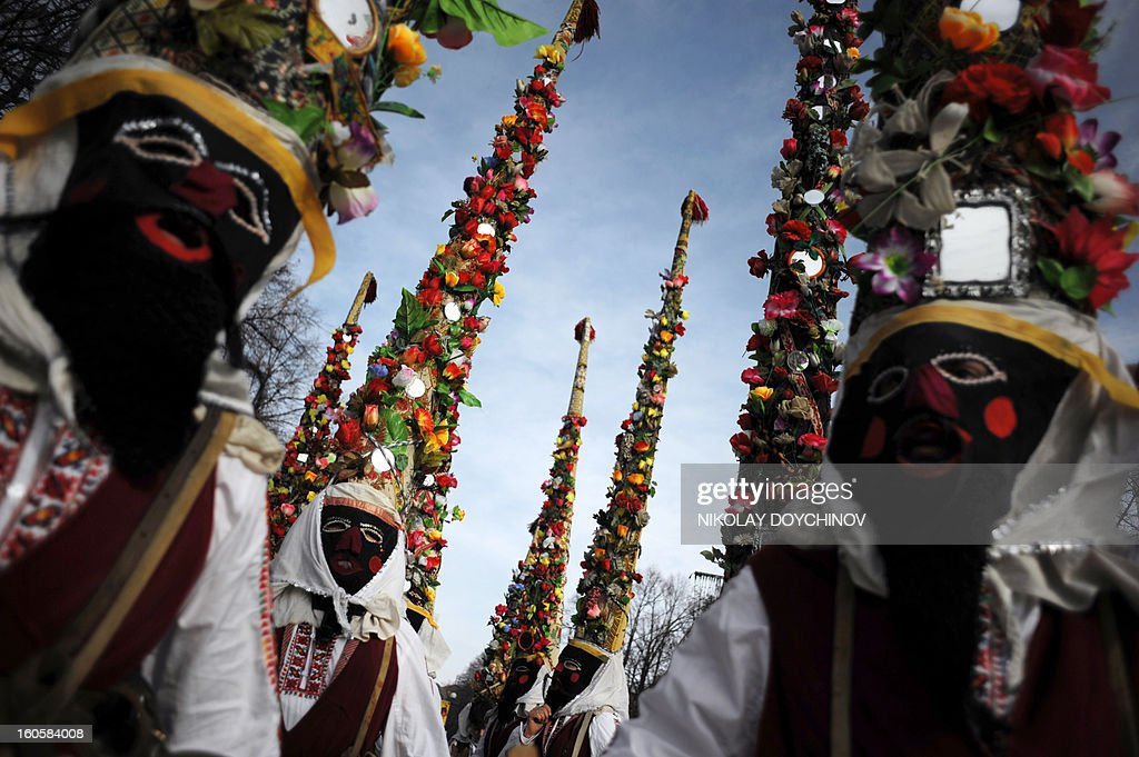 Bulgarian dancers known as 'Kukeri' perform a ritual dance during the International Festival of the Masquerade Games in Pernik near the capital Sofia, on February 3, 2013. The three-day festival, which started on February 1, has participants sporting multi-colored masks, covered with beads, ribbons and woolen tassels while the main dancer, ladened with bells to drive away sickness and evil spirits, sways like a wheat spikelet heavy with grain.