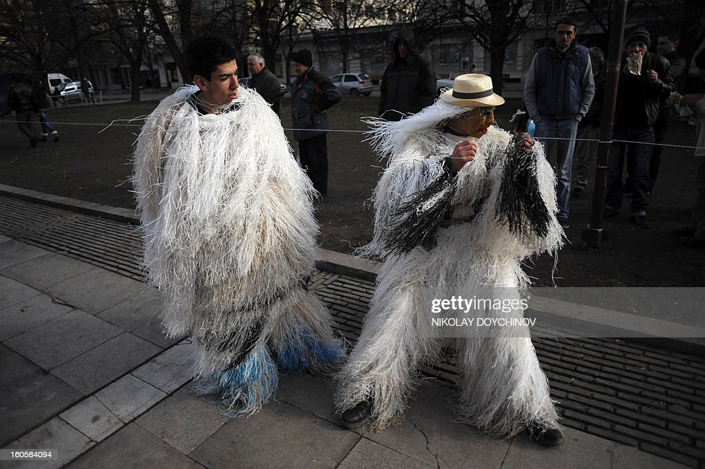 Bulgarian dancers known as 'Kukeri' wait for their performance during the International Festival of the Masquerade Games in Pernik near the capital Sofia, on February 3, 2013. The three-day festival, which started on February 1, has participants sporting multi-colored masks, covered with beads, ribbons and woolen tassels while the main dancer, ladened with bells to drive away sickness and evil spirits, sways like a wheat spikelet heavy with grain. AFP PHOTO / NIKOLAY DOYCHINOV
