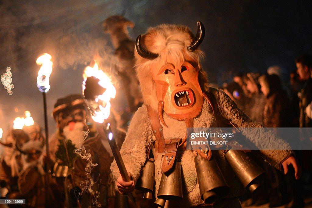 Bulgarian dancers named 'Kukeri' hold torches as they perform a ritual dance during the Kukeri Carnival in the village of Batanovci, western Bulgaria, on January 13, 2013. The Kukeri Carnival is a festival of brightly colored masks and costumes which marks the beginning of the spring. Every participant makes his own multi-colored personal mask, covered with beads, ribbons and woolen tassels. The heavy swaying of the main mummer is meant to represent wheat heavy with grain, and the bells tied around the waist are intended to drive away the evil spirits and the sickness.