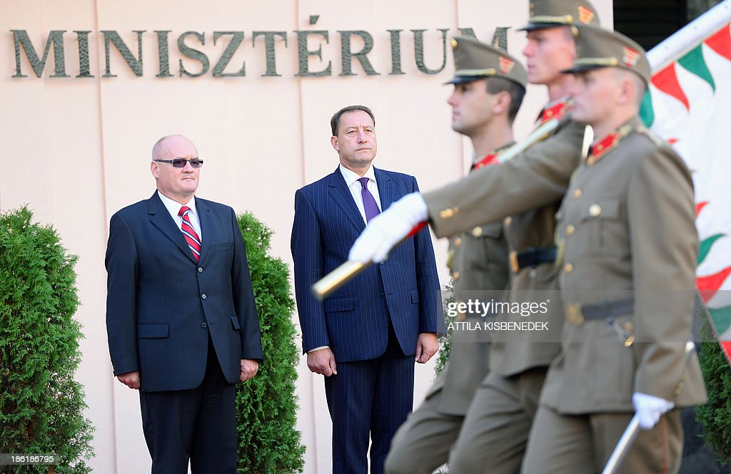 Bulgarian Defence Minister Angel Petrov Naydenov (C) and his Hungarian counterpart Csaba Hende (L) review the guard of honour in front of the defence ministry building of Budapest on October 29, 2013 during a welcoming ceremony. Bulgarian guest is on his one-day official visit to Hungary.