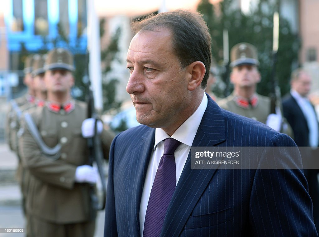 Bulgarian Defence Minister Angel Petrov Naydenov and his Hungarian counterpart review the guard of honour in front of the defence ministry building of Budapest on October 29, 2013 during a welcoming ceremony. Bulgarian guest is on his one-day official visit to Hungary.