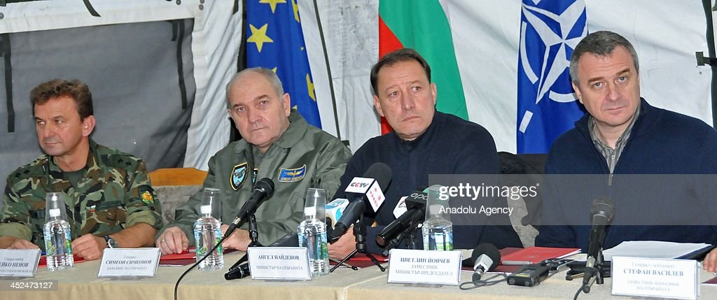 Bulgarian Deputy Prime Minister and Interior Minister Tsvetelin Yovcev (R), National Security Minister Angel Naydenov (R-2) and Chief of Staff Simeon Simeonov (L-2) present the barbed wire to be fenced through 33km route in Golyam Dervent village in Derventski heights at South-East Bulgaria on Bulgaria - Turkey border is presented on November 28, 2013 in Yambol, Bulgaria. Totally 630km barbed wire will be used for 3 meters height wire fence in the region where the surveillance cameras and radar systems are inadequate to control of refugee movement.