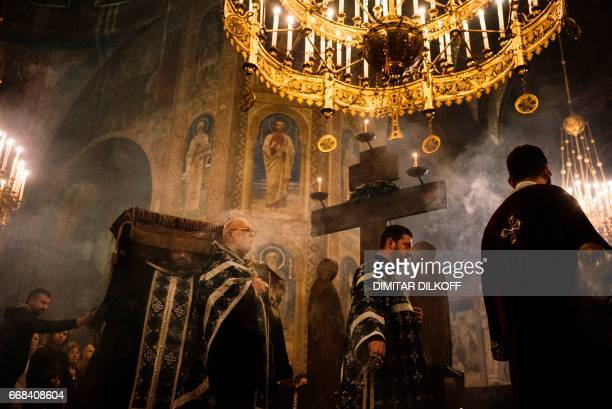 TOPSHOT Bulgarian EastOrthodox priests take part in a Good Friday service at Alexander Nevsky Cathedral in Sofia on April 14 2017 Millions of Greeks...