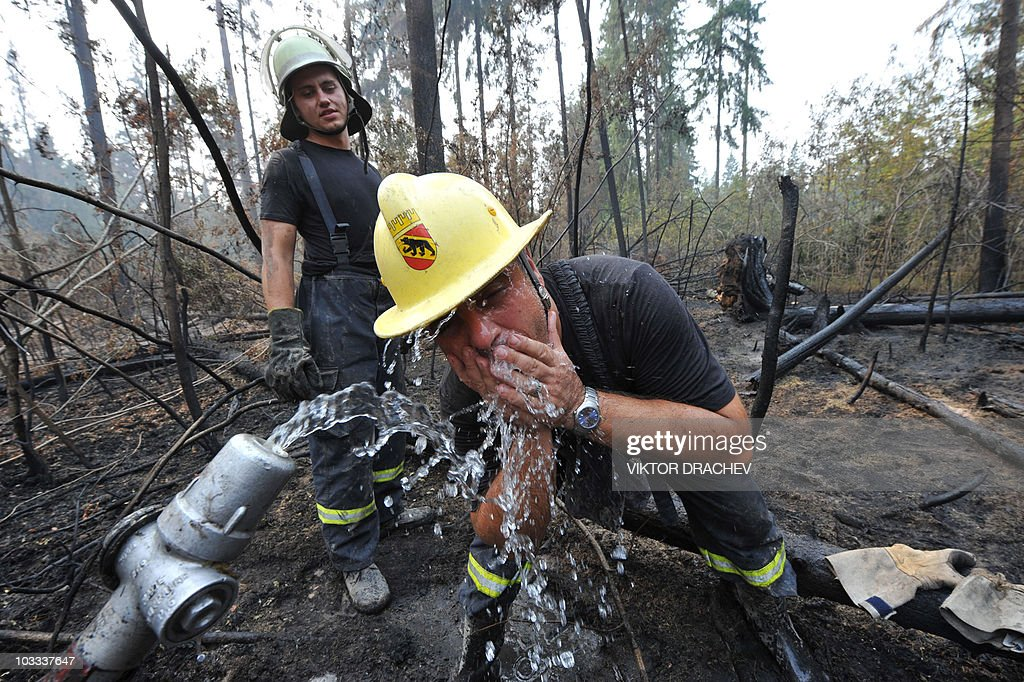 A Bulgarian firefighter drinks water from a fire hose while fighting a blaze in the forest near Noginsk on August 10, 2010. Russia fought a deadly battle to prevent wildfires from engulfing key nuclear sites as alarm mounted over the impact on health of a toxic smoke cloud that has shrouded Moscow.