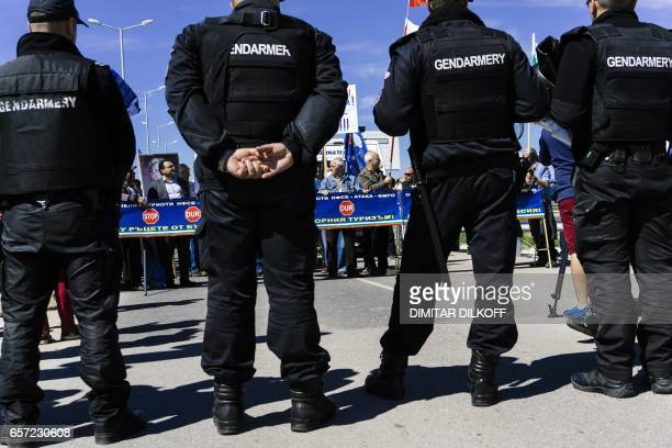 Bulgarian gendarmes stand guard during a rally of Bulgarian nationalists aimed at preventing ethnic Turks with Bulgarian passports from crossing to...