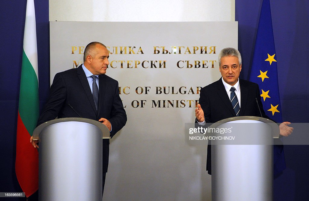 Bulgarian interim Prime Minister-designate Marin Raykov (R) addresses the media on March 13, 2013 next to outgoing Prime minister Boyko Borisov during the official ceremony of transfer of power of the new government in Sofia. After weeks of protests, Bulgaria's new technocrat caretaker government must urgently restore trust in state institutions or risk exacerbating an already dire economic situation in the European Union's poorest country, analysts say.