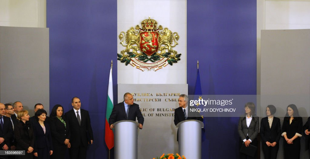 Bulgarian interim Prime Minister-designate Marin Raykov (R), outgoing Prime Minister Boyko Borisov (L) and their governments attend on March 13, 2013 the official ceremony of transfer of power of the new government in Sofia. After weeks of protests, Bulgaria's new technocrat caretaker government must urgently restore trust in state institutions or risk exacerbating an already dire economic situation in the European Union's poorest country, analysts say.