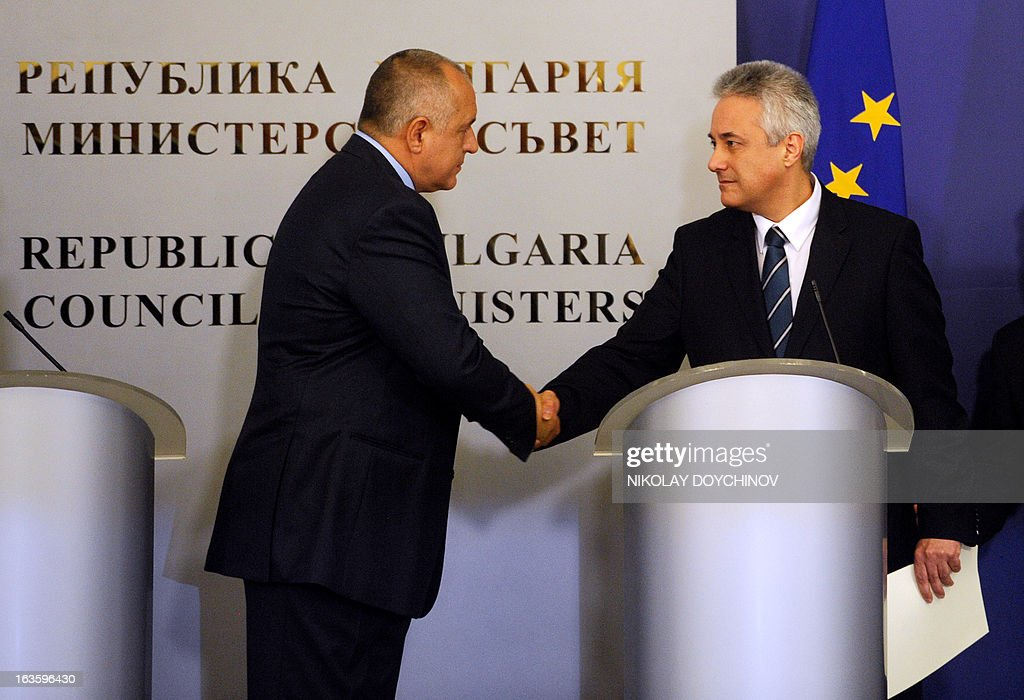Bulgarian interim Prime Minister-designate Marin Raykov (R) shakes hands on March 13, 2013 with outgoing Bulgarian Prime Minister Boyko Borisov during the official ceremony of transfer of power of the new government in Sofia. After weeks of protests, Bulgaria's new technocrat caretaker government must urgently restore trust in state institutions or risk exacerbating an already dire economic situation in the European Union's poorest country, analysts say.
