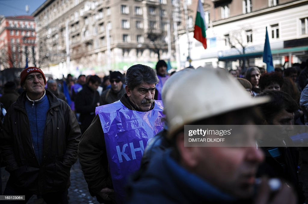 Bulgarian miners attend a protest in downtown Sofia on March 5, 2013. Over 1,500 Bulgarian miners rallied fearing for their jobs after the announced temporary shutdowns of coal-fired plants in the crisis-hit country to balance low consumption and exports. The protest, organised by the two primary trade unions KNSB and Podkrepa, added to snowballing public discontent over high electricity bills, growing poverty and corruption in EU's poorest country that toppled the right wing government two weeks ago. AFP PHOTO / DIMITAR DILKOFF
