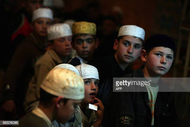 Bulgarian Muslim boys attend a religious ritual marking Laylat AlQadr on the 27th day of the holy fasting month of Ramadan in the town of Madan 293...