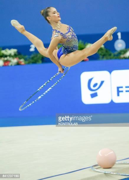 Bulgarian Nevjana Vladinova performs the hoop exercise during the FIG 35th Rhytmic Gymnastic World Championship in Pesaro