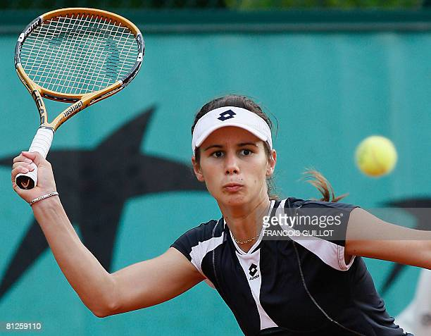 Bulgarian player Tsvetana Pironkova eyes the ball for a return to her Chinese Taipei opponent YungJan Chan during their French tennis Open first...