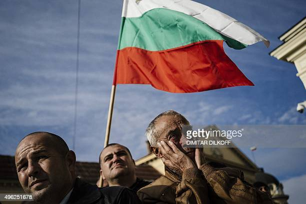 Bulgarian police members holding national flags protest against government's plans to slash their social benefits in Sofia on November 8 2015...