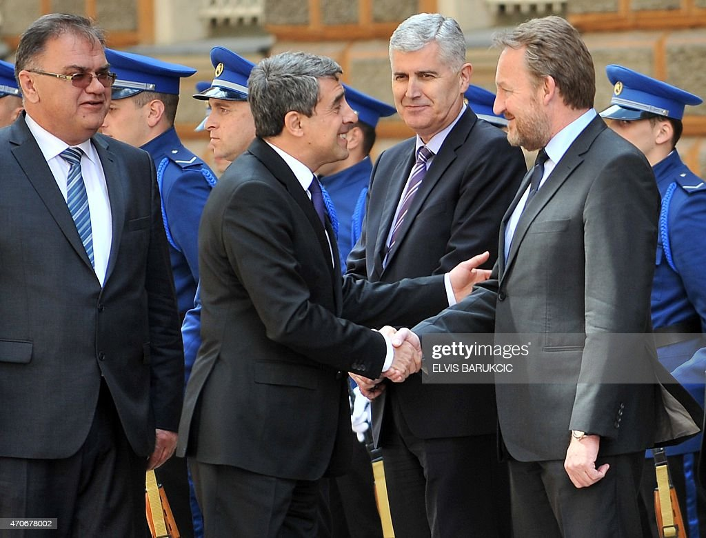 Bulgarian President <a gi-track='captionPersonalityLinkClicked' href=/galleries/search?phrase=Rosen+Plevneliev&family=editorial&specificpeople=6873737 ng-click='$event.stopPropagation()'>Rosen Plevneliev</a> (C), flanked by Chairman of Bosnia and Herzegovina's tripartite presidency, Mladen Ivanic (L), shakes hands with members of Bosnia and Herzegovina's tripartite Presidency, Dragan Covic (2nd R) and <a gi-track='captionPersonalityLinkClicked' href=/galleries/search?phrase=Bakir+Izetbegovic&family=editorial&specificpeople=7227224 ng-click='$event.stopPropagation()'>Bakir Izetbegovic</a> (R), during a welcoming ceremony in Sarajevo on April 22, 2015. Bulgaria's President is on a two-day official visit.