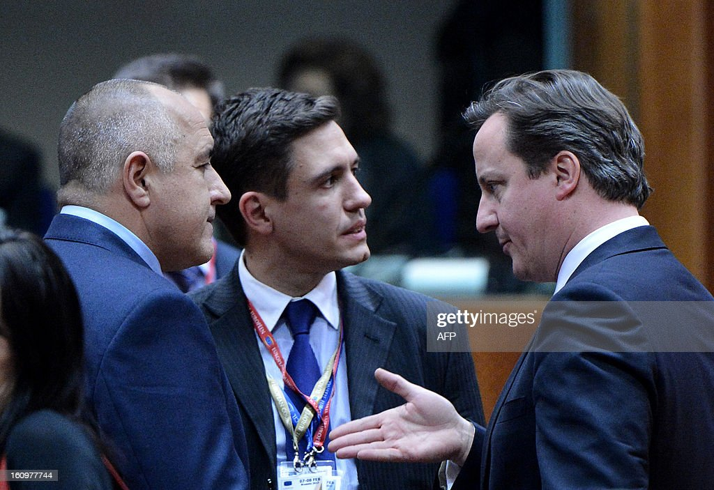 Bulgarian Prime Minister Boyko Borisov (L) and British Prime Minister David Cameron (R) chat during a roundtable meeting at the EU Headquarters on February 7, 2013 in Brussels, on the first day of a two-day European Union leaders summit. European Union leaders head into a fresh clash over the EU's budget with the only certainty being that proposals for several years will be cut back.