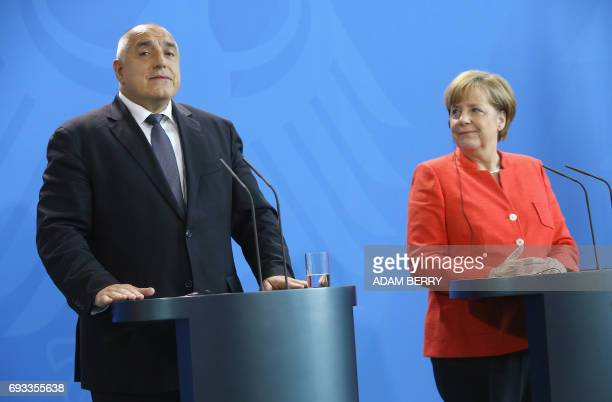 Bulgarian Prime Minister Boyko Borisov and German Chancellor Angela Merkel attend a joint press conference in the Chancellery in Berlin on June 7...