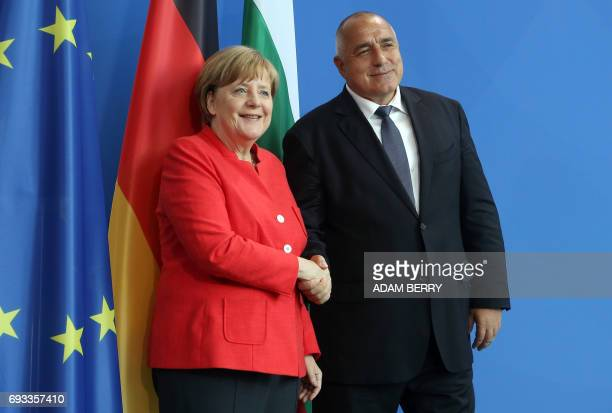 Bulgarian Prime Minister Boyko Borisov and German Chancellor Angela Merkel shake hands after a joint press conference in the Chancellery in Berlin on...
