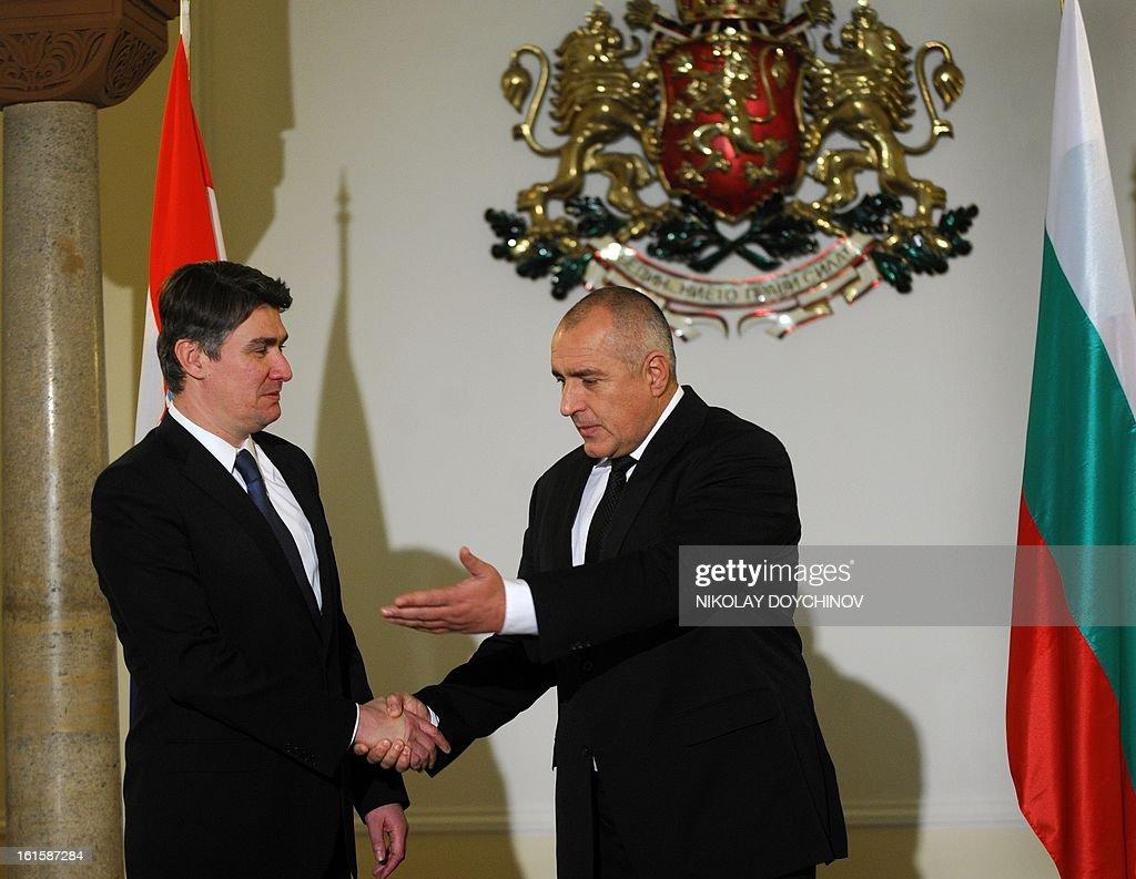 Bulgarian Prime Minister Boyko Borisov (R) welcomes his Croatian counterpart Zoran Milanovic prior their meeting in Sofia on February 12, 2013. AFP PHOTO / NIKOLAY DOYCHINOV