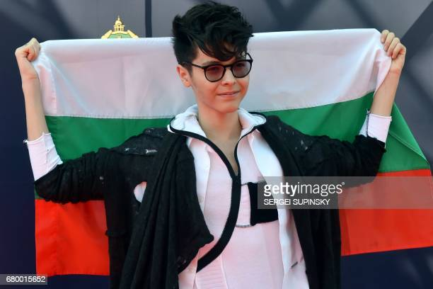 Bulgarian singer Kristian Kostov poses with Bulgaria's national flag during the Red Carpet ceremony of the 2017 Eurovision song Contest in Kiev on...